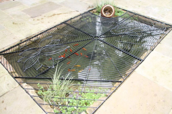 A koi pond with a mesh cover