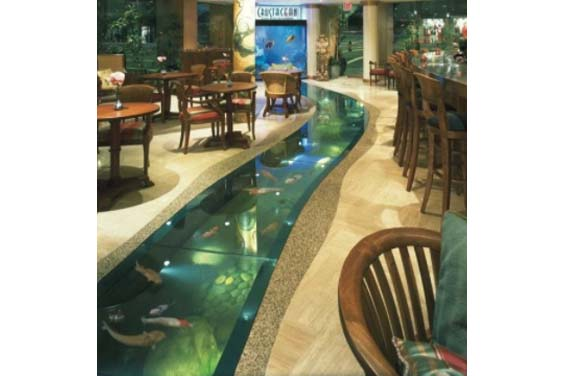 A lazy river pond inside a restaurant